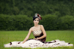 Attractive lady in formal  gown at park Royalty Free Stock Image