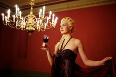 Attractive lady with a glass of red wine. Royalty Free Stock Photography