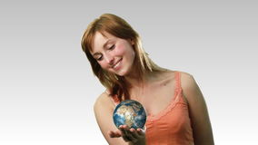 Attractive lady holding the earth Stock Image