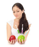 Attractive lady holding GMO apple with syringe. Young attractive lady holding GMO apple with three syringe on white Royalty Free Stock Images