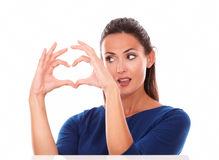 Attractive lady looking at a love sign Royalty Free Stock Image