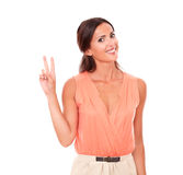 Attractive lady making a victory sign Royalty Free Stock Photography
