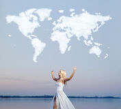 Attractive lady over the cloud world map Royalty Free Stock Image