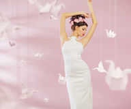 Attractive lady among the paper swans Royalty Free Stock Photos