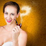Attractive lady pondering solutions with pipe Stock Images