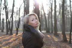 Attractive lady posing in park. Stock Photo