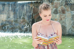 Attractive lady reading from agenda or diary outdoor Royalty Free Stock Image