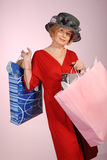 Attractive lady senior citizen with shopping bags royalty free stock photo