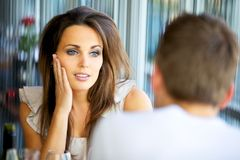 Attractive Lady Staring at Her Boyfriend with Love Royalty Free Stock Photo