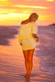 Attractive Lady at the tropical beach in sunset. Stock Photo