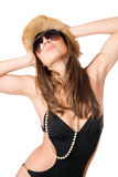 Attractive lady wearing swimsuit and fur-cap Stock Photos