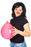 Attractive lady whit clown nose and a globe stock images