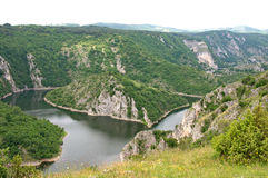 Attractive landscape of the Canyon of the River Uvac in Serbia. Panoramic scene of the Canyon of the river Uvac. It is situated on the Pester plateau, karst Stock Photo