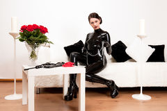 Attractive latex mistress waiting for you Stock Photos