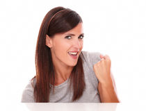 Attractive latin female with victory gesture stock image