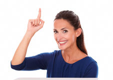 Attractive latin with finger pointing up stock image