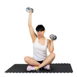 Attractive latin girl doing gymnastics. With weights isolated on white background Royalty Free Stock Photography