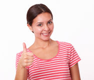 Attractive latin girl with ok sign royalty free stock photography
