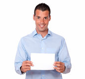 Attractive latin guy holding a white card Royalty Free Stock Photography