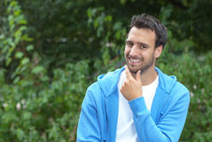 Attractive latin guy looking at camera in a park Royalty Free Stock Images