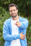 Attractive latin guy pointing at camera in a park Stock Photography