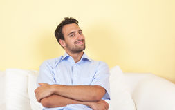 Attractive latin guy relaxing on a sofa Royalty Free Stock Images
