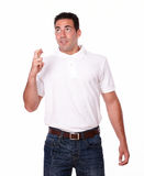 Attractive latin male with luck gesture Stock Photo