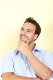 Attractive latin man has a great idea in his living room Stock Photography