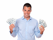 Attractive latin man holding his money royalty free stock image