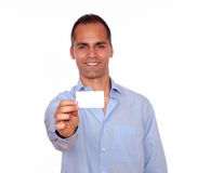 Attractive latin man holding a white card stock images