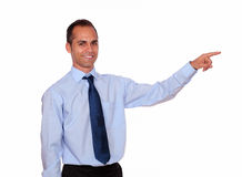 Attractive latin man pointing to his left Stock Photo