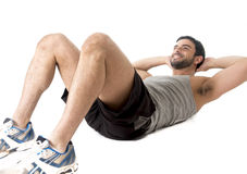 Attractive latin sport man wearing running clothes doing  sit up or crunch Stock Photos