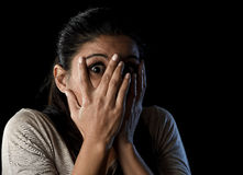 Attractive Latin woman scared terrorized and horrified covering her eyes Royalty Free Stock Photos