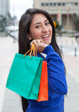 Attractive latin woman with shopping bags in the city Stock Photography