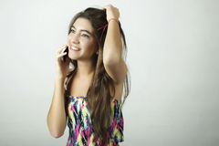 Attractive latin woman talking on mobile phone Royalty Free Stock Photo