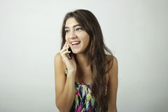 Attractive latin woman talking on mobile phone Royalty Free Stock Photography
