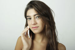 Attractive latin woman talking on mobile phone Royalty Free Stock Image