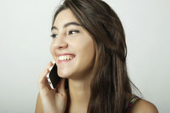 Attractive latin woman talking on mobile phone Stock Photography