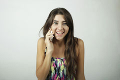 Attractive latin woman talking on mobile phone Stock Photo