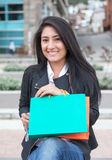 Attractive latin woman with two shopping bags Royalty Free Stock Images