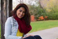 Attractive Latino woman outdoors during autumn Stock Photo