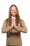 Attractive, laughing hippie with hands together. Closeup of an attractive, happy, laughing male hippie with hands held together and facing the camera. Isolated royalty free stock photo