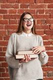 Attractive laughing woman with books portrait Stock Images