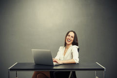 Attractive laughing woman working Stock Photo