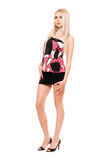 Attractive leggy young blonde in black miniskirt Stock Images