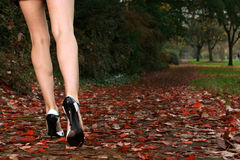 Attractive legs. Concept image of a woman's attractive legs walking down a path. Shallow depth of field, focus point is at models left leg and shoe Royalty Free Stock Photos