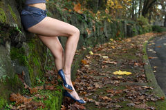 Attractive legs. Concept image of a woman's attractive legs along a path. Shallow depth of field focus point is at models  legs and shorts Royalty Free Stock Photo