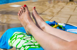 Attractive Legs, Feet and toes on a sunbed. Long legs on a sunbed Stock Images