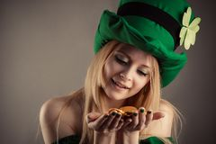 Attractive leprechaun girl with coins in hands Royalty Free Stock Images