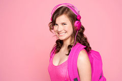 attractive listening music schoolgirl to Arkivfoto